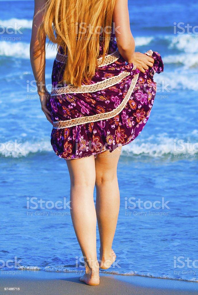 Sexy woman walking into the sea royalty-free stock photo