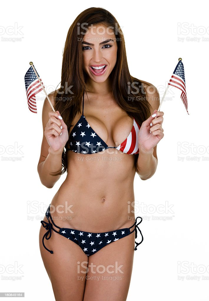 Sexy woman waving American flags stock photo