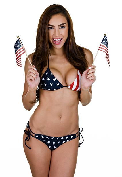 Sexy woman waving American flags stock photo