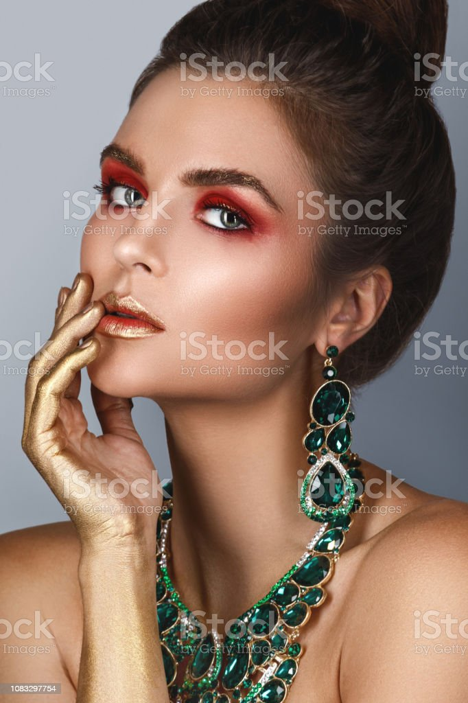 Gorgeous and sexy woman wearing big beautiful necklace with a lot of...