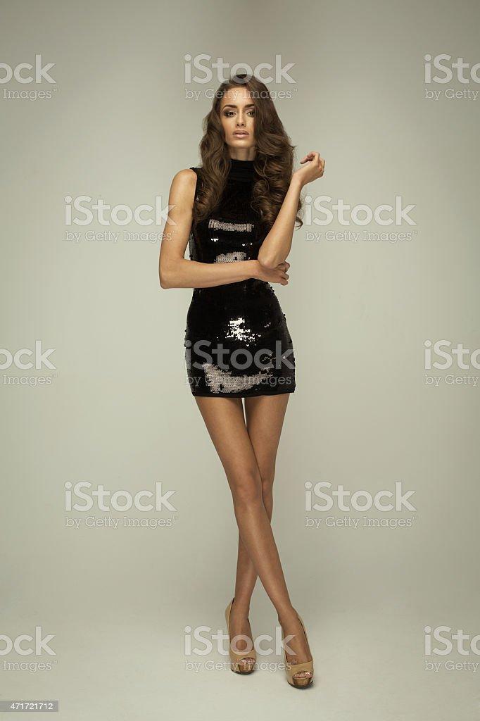 Sexy woman wearing black fashion dress stock photo