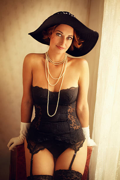 sexy woman wearing lingerie and hat stock photo