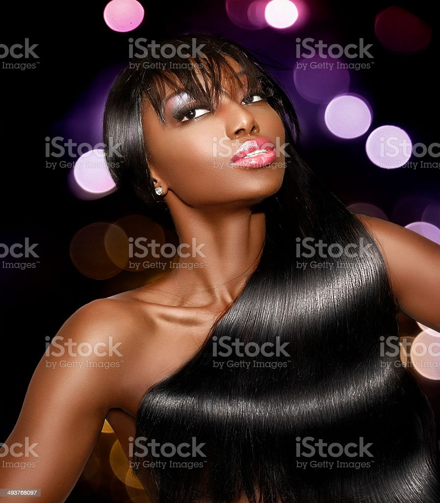 Sexy woman wearing wavy hairstyle on a nightlife background stock photo