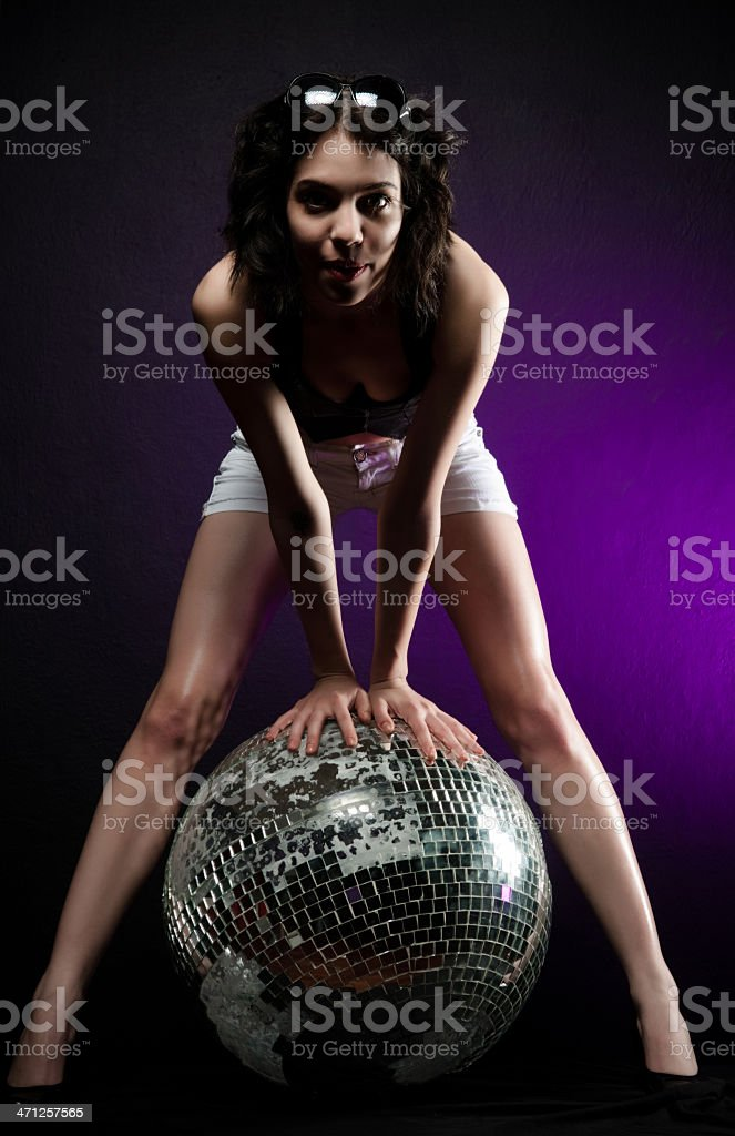 Sexy woman standing by the disco balls side