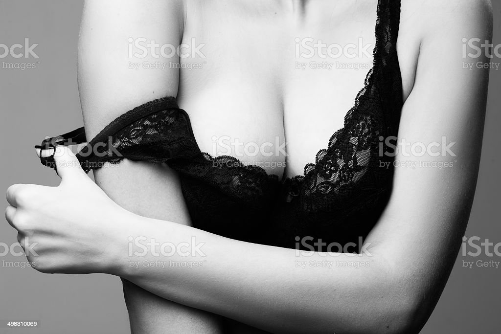 sexy woman with big breasts in black bra stock photo