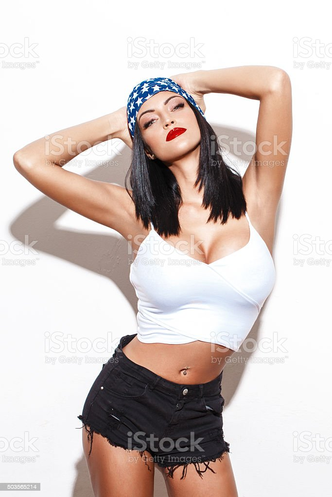 Sexy woman with big tits and USA handscarf stock photo