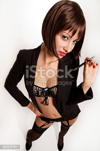 istock Sexy woman with black suit and bra holding pen 520237911