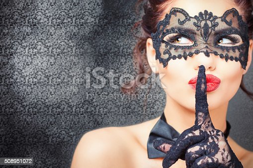istock Sexy woman with carnival mask 508951072