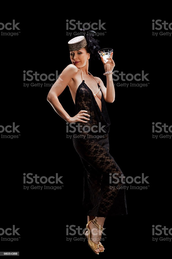 Donna sexy con un bicchiere di cocktail foto stock royalty-free