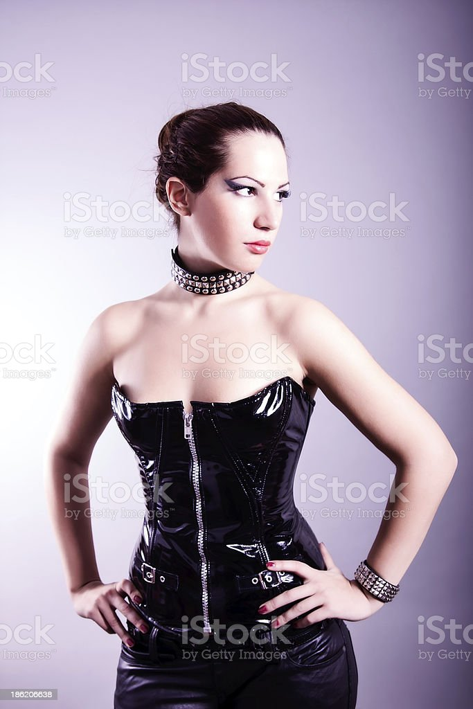 Sexy Woman With Hourglass Figure In Black Leather Corset