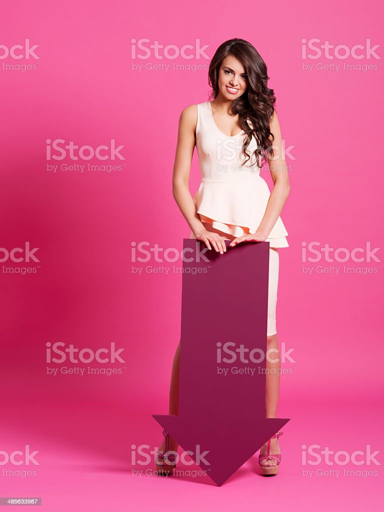 Sexy woman with moving down arrow stock photo