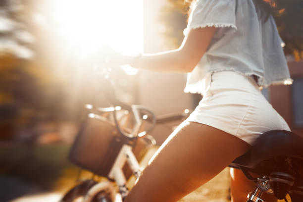 Sexy woman with perfect butt riding bicycle Sexy woman with perfect butt riding bicycle hot sexy butts stock pictures, royalty-free photos & images