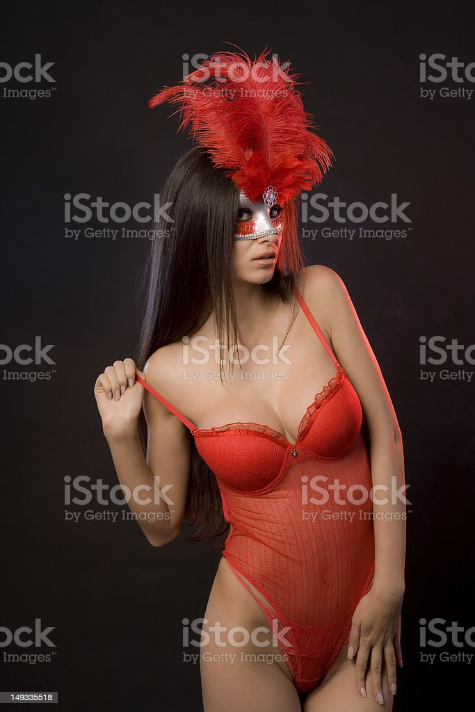 Sexy woman with red lingerie and mask. royalty-free stock photo