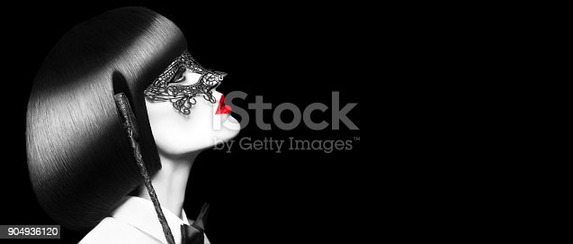 istock Sexy woman with red lips mask and whip selective coloring banner bdsm 904936120