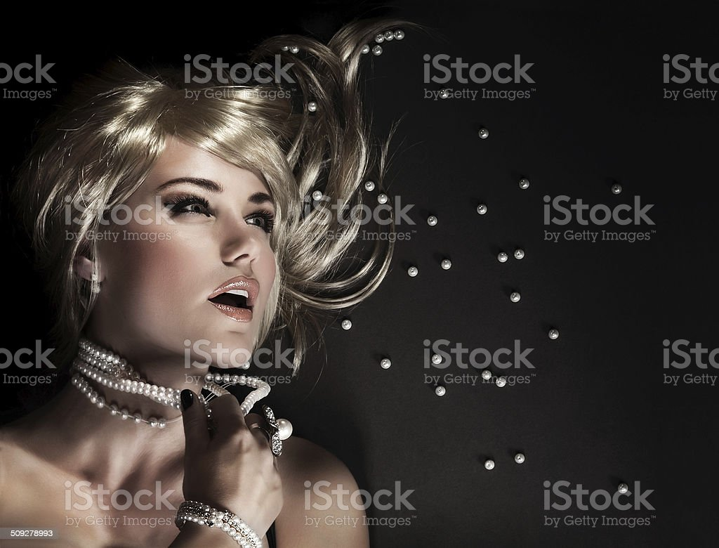 Sexy woman with torn beads stock photo