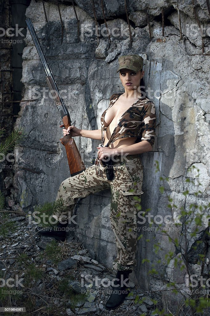 Sexy woman with weapon stock photo