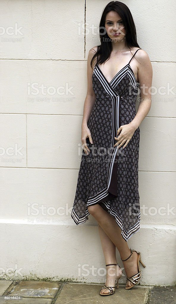 Sexy Women by a wall royalty-free stock photo