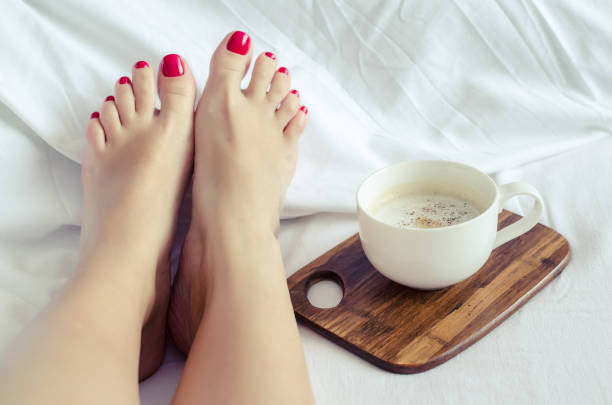 Sexy women relaxing in bad with cup of hot coffee stock photo