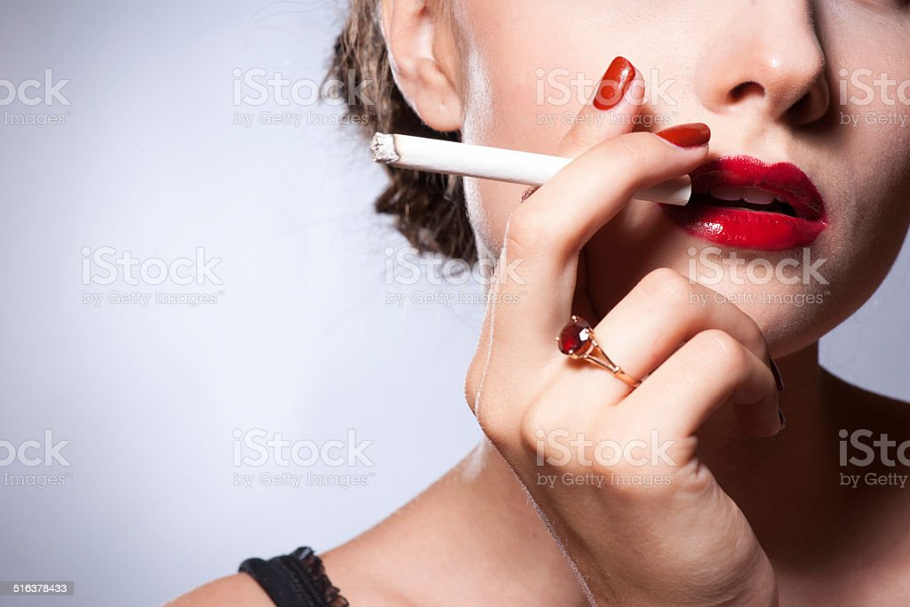 sexy young adult smoking a cigarette stock photo