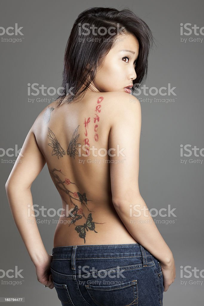 Sexy Young Asian Woman with Tattoo royalty-free stock photo