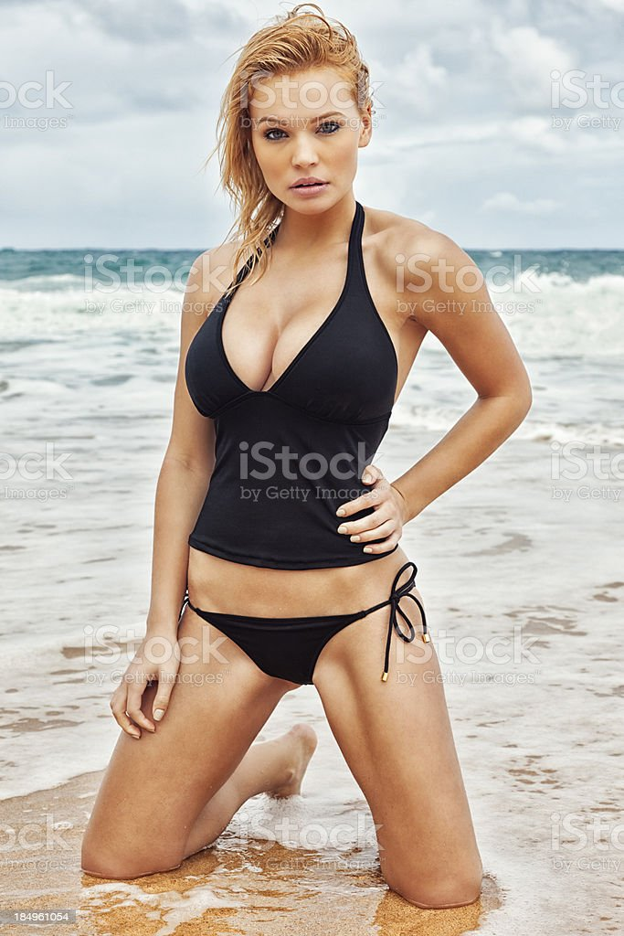 Sexy Young Blonde Woman in Black Tankini Posing on Beach royalty-free stock photo