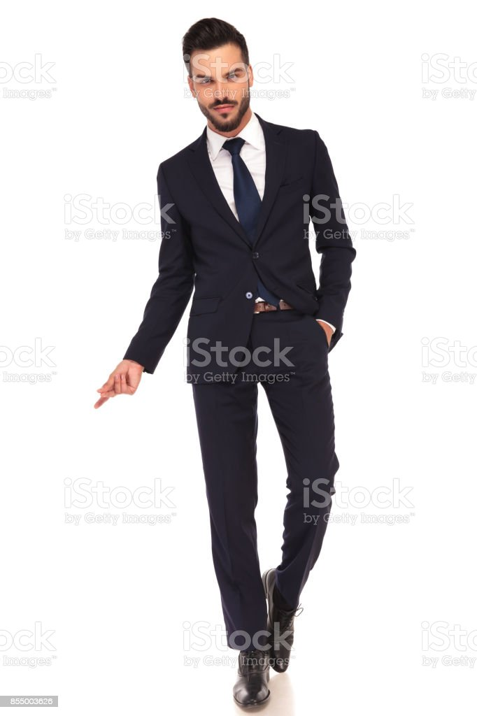 sexy young business man snapping his fingers stock photo