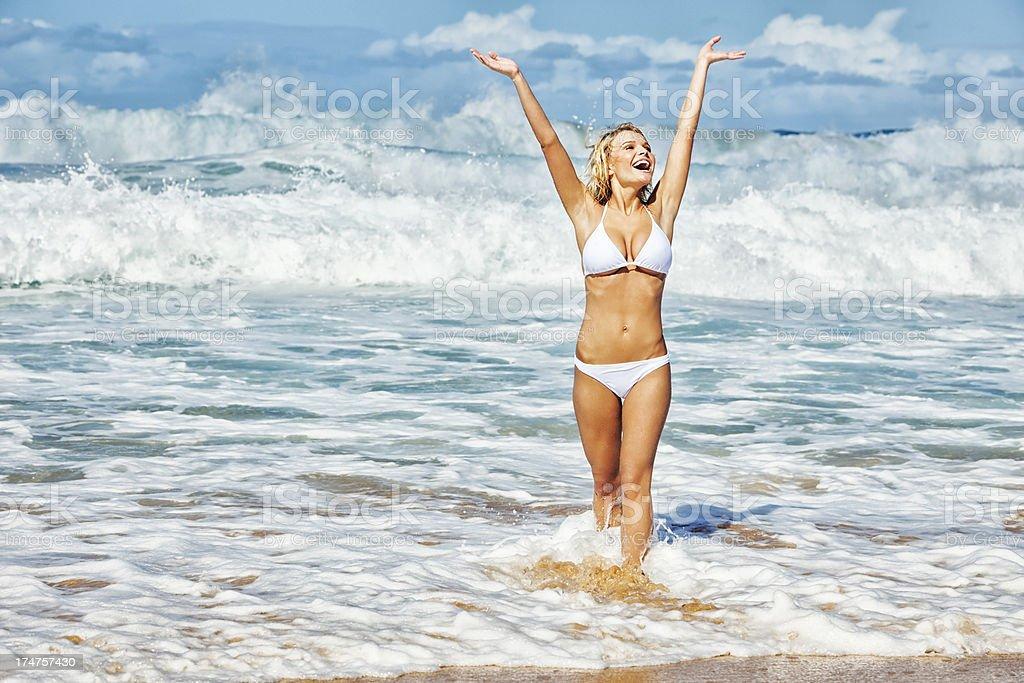 Sexy Young Carefree Woman on Hawaiian Beach wearing White Bikini royalty-free stock photo