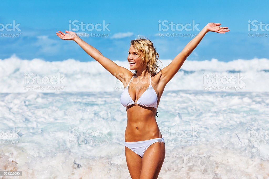 Sexy Young Carefree Woman on Hawaiian Beach wearing White Bikini stock photo