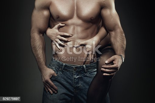 istock Sexy young couple body at night closeup 529275697