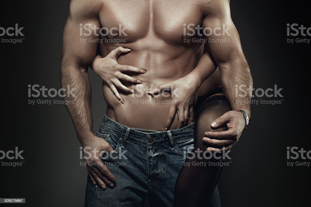 Sexy young couple body at night closeup stock photo