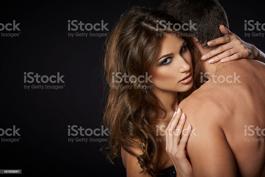 Sexy young couple embracing stock photo