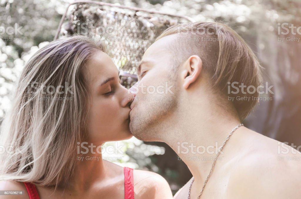 Sexy Young Couple Kissing In Nature Stock Photo More Pictures Of