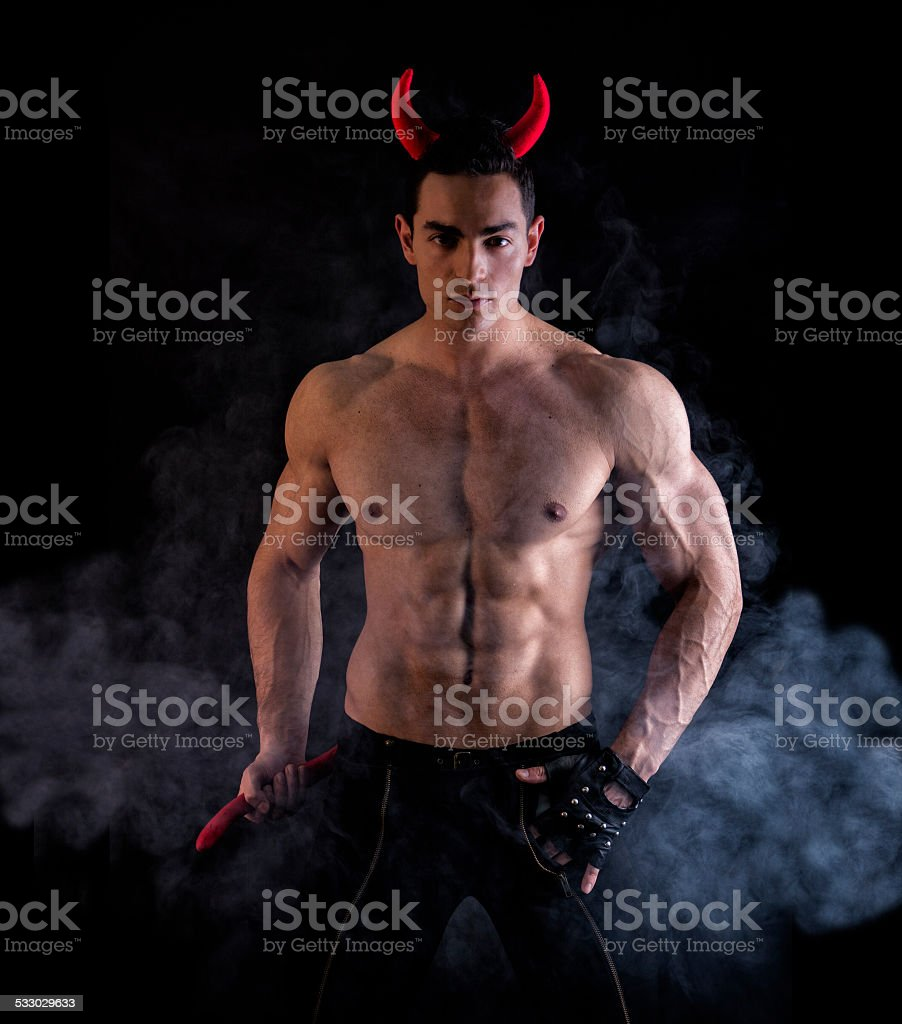 Sexy Young Man Wearing Devilish Horn Accessories stock photo