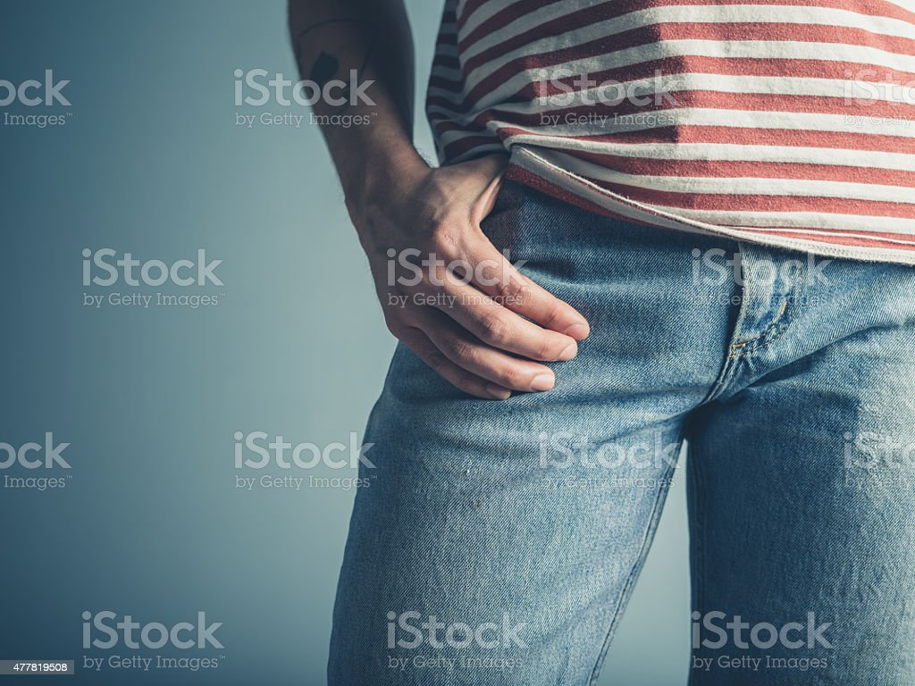 Sexy young man with hand in his pocket stock photo