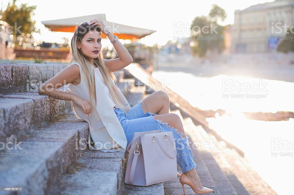Sexy young stylish hipster woman posing stock photo
