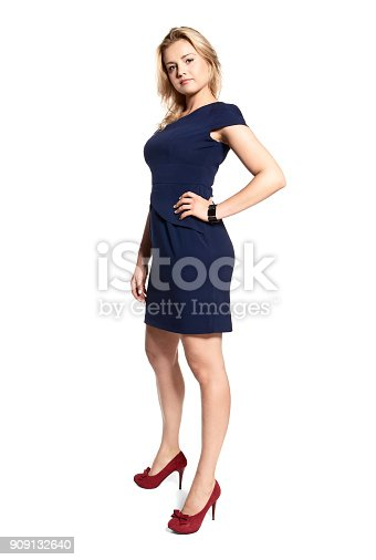 istock Sexy Young Woman in a Navy Blue Dress 909132640