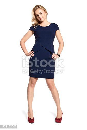 istock Sexy Young Woman in a Navy Blue Dress 909133342