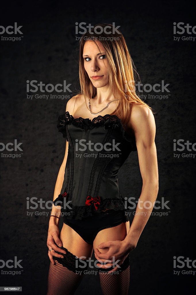 Sexy young woman in black basque and stockings royalty-free stock photo