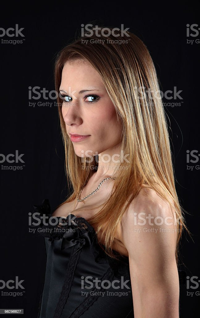 Sexy young woman in black basque with dark background royalty-free stock photo