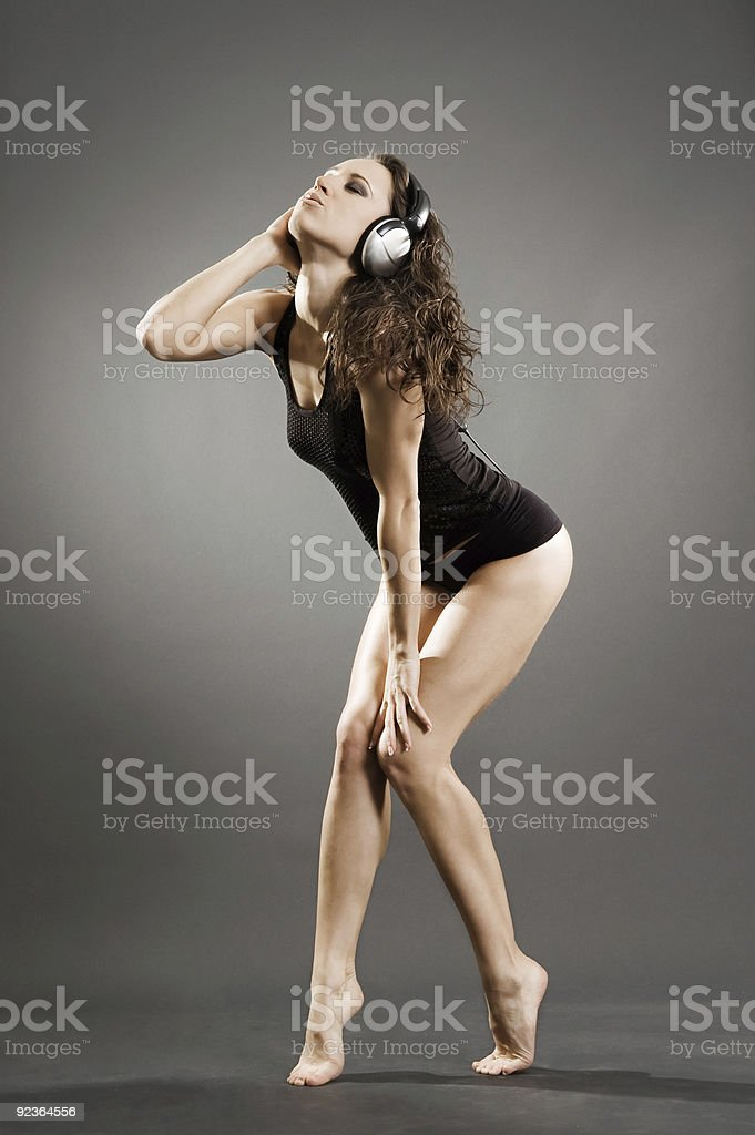 sexy young woman in headphones royalty-free stock photo