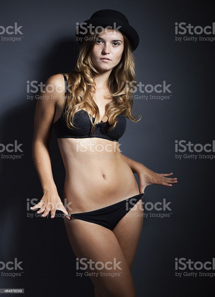 efb2570ff Sexy Young Woman In Lingerie And Hat Dark Background Stock Photo ...
