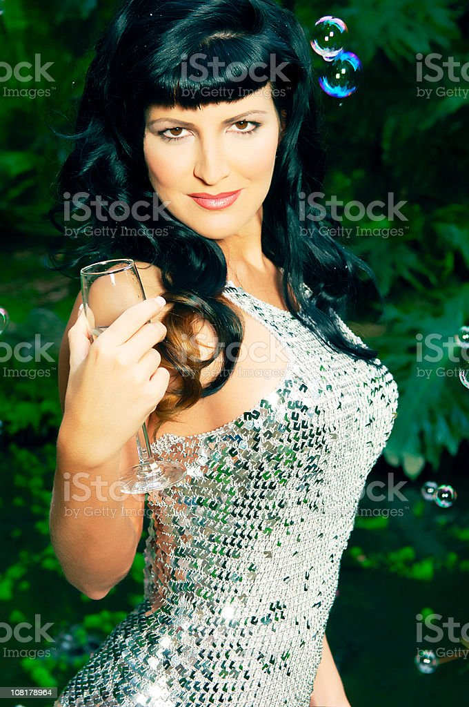 Sexy Young Woman in Sequined Dress Sips Champagne royalty-free stock photo