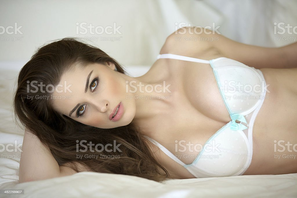 78738b4b405 Sexy Young Woman Laying On Bed Stock Photo & More Pictures of 20-29 ...