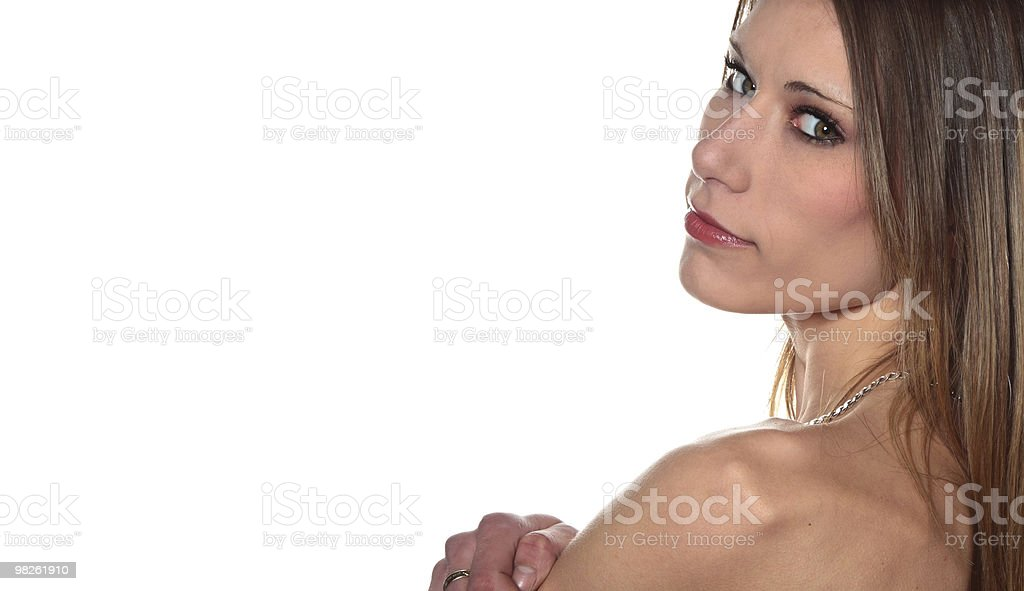 Sexy young woman looking over bare shoulders royalty-free stock photo
