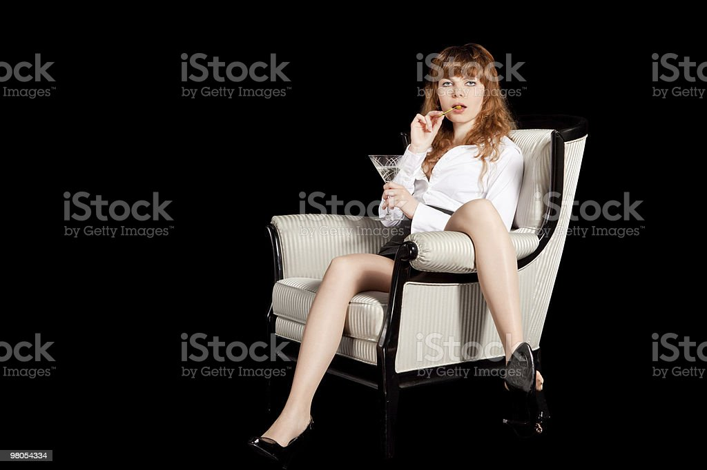 sexy young woman on arm chair,  with glass of cocktail royalty-free stock photo
