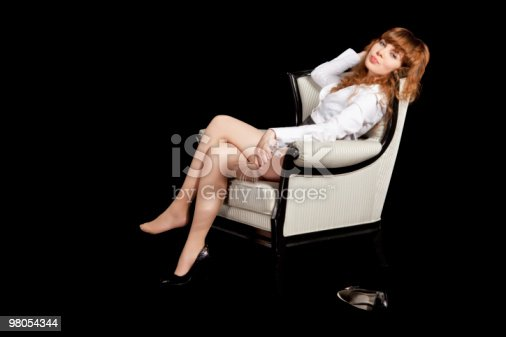 Sexy Young Woman On Arm Chair With Glass Of Cocktail Stock Photo & More Pictures of Adult
