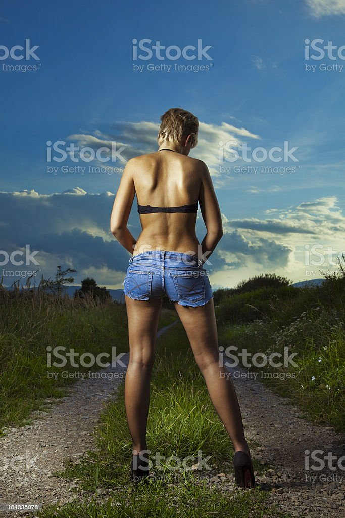 Sexy young woman on the road royalty-free stock photo