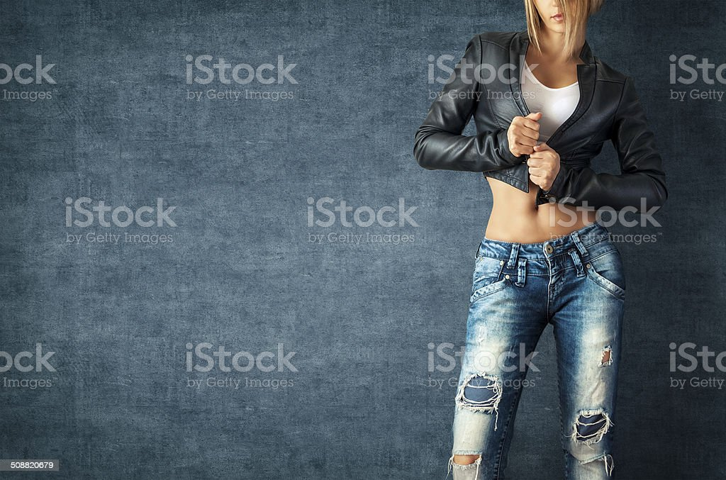 Sexy young woman Sexy young woman in a trendy clothes on a grunge background Adult Stock Photo