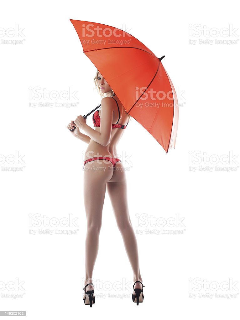 Sexy young woman posing with umbrella royalty-free stock photo