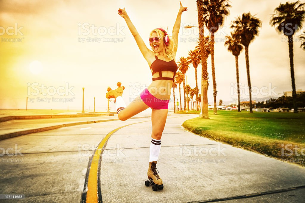 Sexy Young Woman Roller Skating stock photo